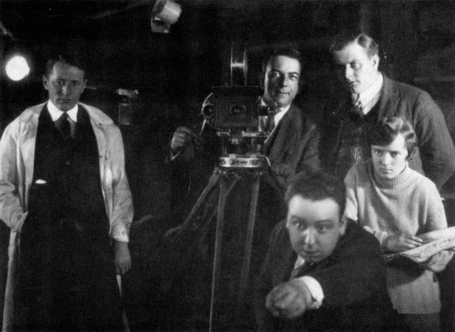 Promotional Photo of Hitch Directing 'The Mountain Eagle' (1927) with Alma Reville sitting behind him
