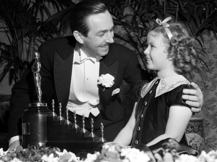 Shirley Temple Presents Disney with his Oscar for 'Snow White and the Seven Dwarfs'