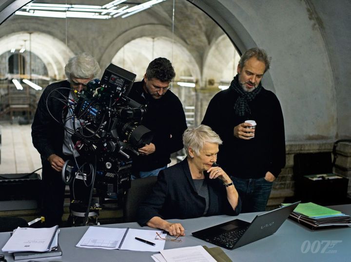 Roger Deakins, an assistant, Mendes and Judi Dench filming a scene for 'Skyfall' 2011
