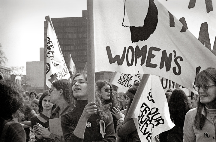 """Woman with banner"" Photo credit: Virginia Blaisdell"