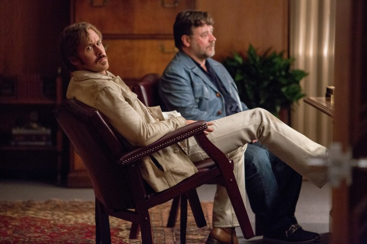 "RYAN GOSLING as Holland March and RUSSELL CROWE as Jackson Healy in Warner Bros. Pictures' action comedy ""THE NICE GUYS,"" a Silver Pictures production, a Warner Bros. Pictures release."