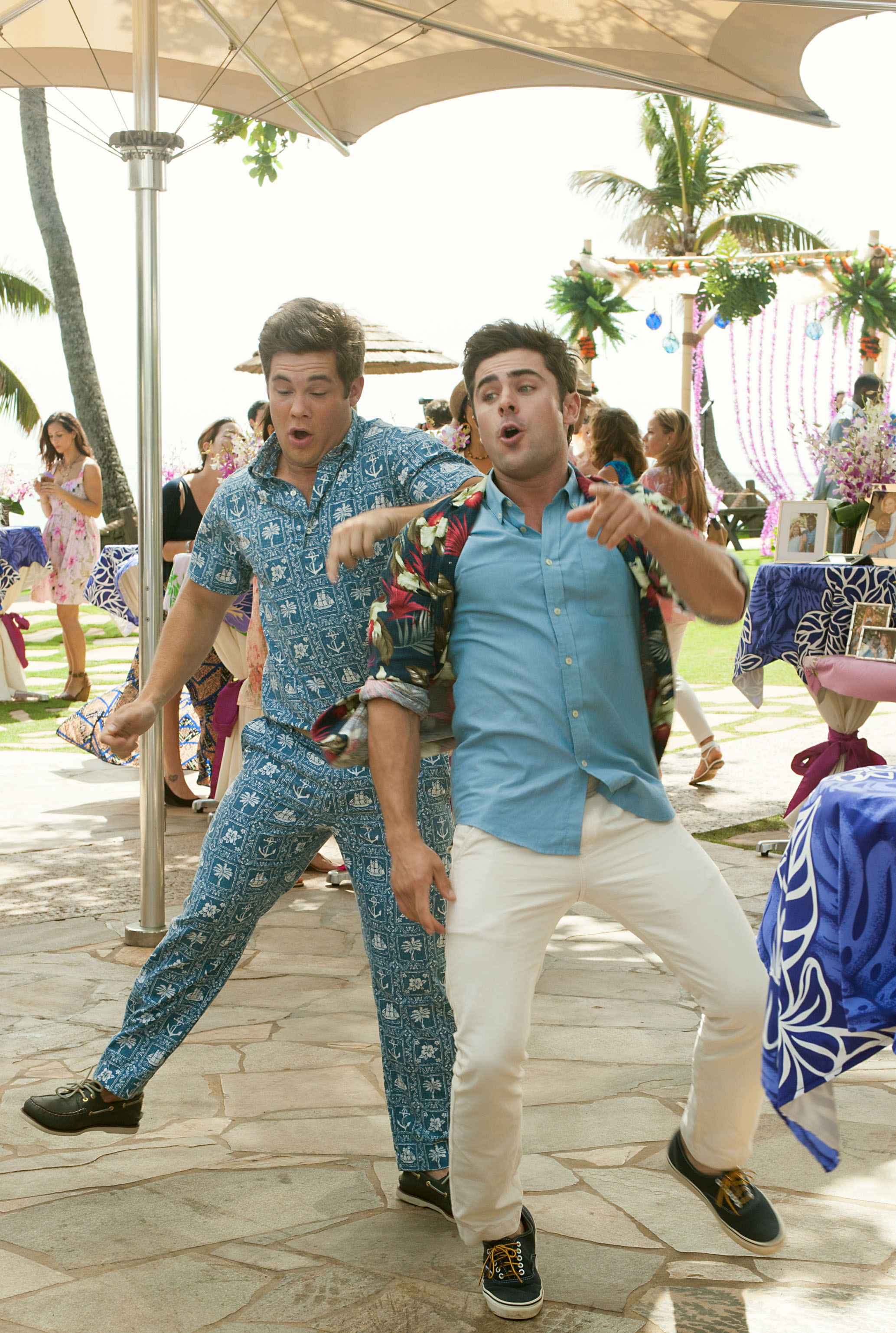 Mike (Adam Devine, left) and his brother Dave (Zac Efron) bust some moves at their sister's wedding. Photo Credit: Gemma LaMana.